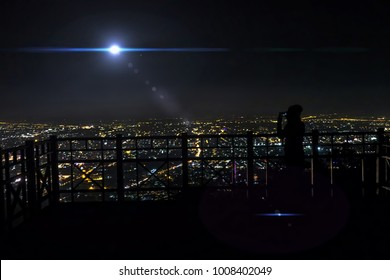 Amazing fantastic sci-fi background - extraterrestrial aliens spaceship fly above the night city, Alien visitor