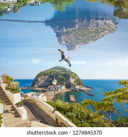 Amazing fantastic unreal world, collage with famous landmarks of Ischia Island, Italy. Aragonese Castle turned upside down above big rock in small village Sant'Angelo, Ischia.