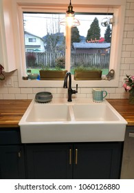 Amazing farmhouse sink oversized with a large window above it at a house remodel and renovation in Oregon.