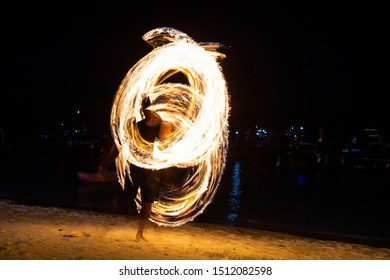 Amazing fire dancers Swing fire dancing show fire show on the beach  in Thailand