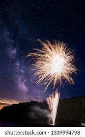 Amazing fireworks display on Lake Joseph, Ontario, with the milky way visible above.
