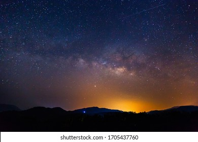 Amazing galaxy with the milky way and golden bright light before sunrise, The starry in the night sky are visible from earth - Shutterstock ID 1705437760