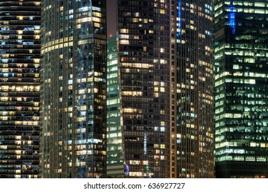 Amazing glowing windows of skyscrapers at evening. View of modern office high-rise buildings in Singapore. Scenic night cityscape.