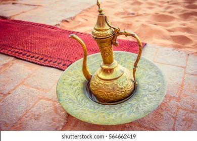 amazing golden arabic coffee pot is served in bedouin tent