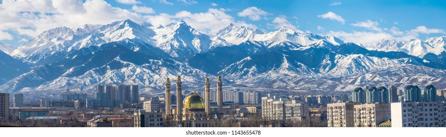 Amazing good day with clouds over the Almaty city near the Tian Shan mountains in winter. Best place for active life, vacation, hiking and trekking in Kazakhstan. Best view from the window.
