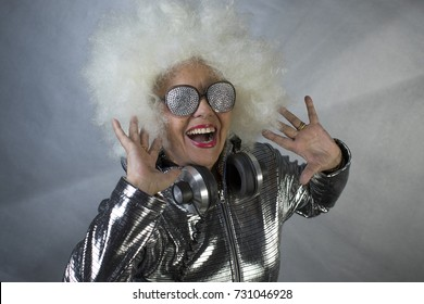 an amazing grandma DJ, older lady with headphones, partying in a disco setting