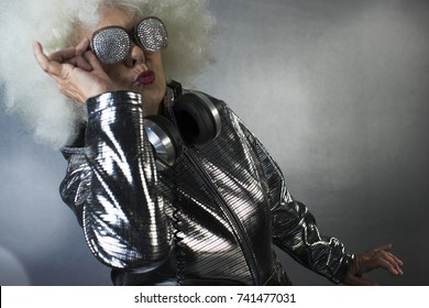 an amazing grandma DJ, older lady with a ghettoblaster, partying in a disco setting