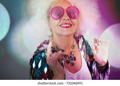 an amazing grandma, older lady partying in a disco setting