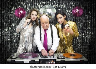 amazing grandpa DJ and his two beautiful gogo dancers