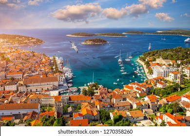 Amazing historic town of Hvar aerial view, Dalmatia, Croatia. Island of Hvar bay aerial view, Dalmatia, Croatia. Harbor of old Adriatic island town Hvar. Popular touristic destination of Croatia.