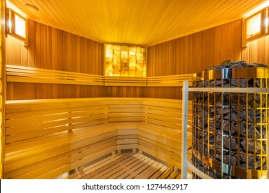 Amazing home sauna room with cedar wood walls and bench
