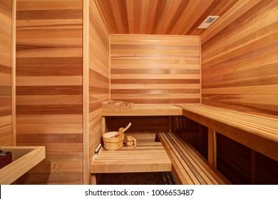 Amazing home sauna room with teak surround as well as wraparound teak bench over tiled floor. Northwest, USA