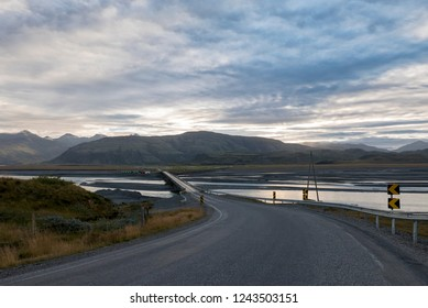 Amazing icelandic landscape of mountains and grass  with the road in the East Fjords, Iceland
