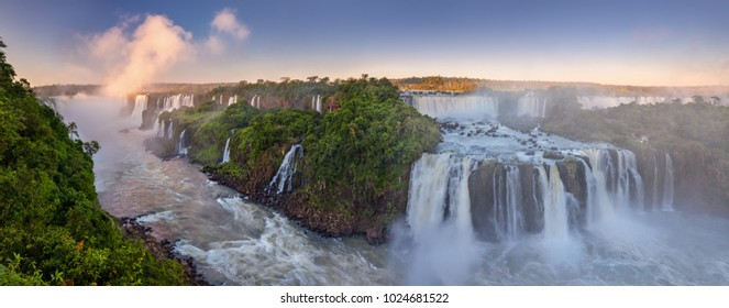 The amazing Iguazu falls, summer landscape with scenic waterfalls.