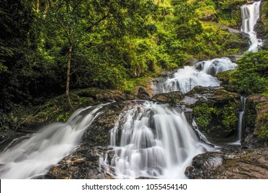 Amazing Iruppu waterfalls in Coorg/Madikeri, Karnataka, India. Western ghats falls in long exposure. Green trees & forest. Milky waterfalls.  Karnataka tourism, forest eco trail