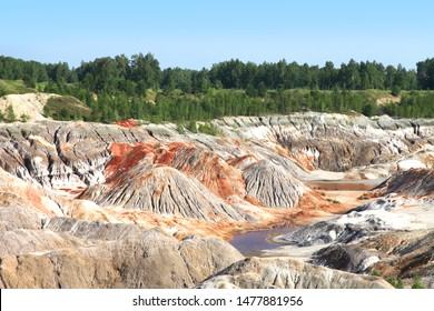 Amazing kaoline china stone abandoned quarry open pit mine, Old abandoned clay quarry, Kaolin quarry in Russia Ural, panorama of industrial clay hills in Ural, mountain in Ural, lifeless desert