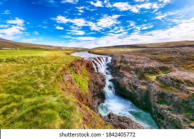 Amazing Kolufossar waterfall at summer sunny day.  Popular tourist travel destination in Iceland . Location: Kolufossar waterfall, Vestur-Hunavatnssysla, Iceland, Europe