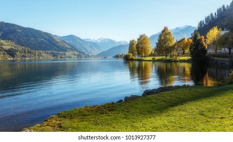 Amazing landscape of alpine lake with crystal clear green water and Perfect blue sky. Panoramic view of beautiful mountain landscape in Alps with Zeller Lake in Zell am See, Salzburger Land, Austria