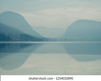 Amazing landscape. Lake and mountain. Reflection on the lake. Artstic colours.