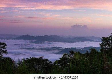 Amazing landscape with mountain range and cloud inversion at sunrise.
