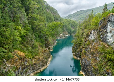 An amazing landscape at north Chilean Patagonia, Puelo river moves around the narrow gorge with its turquoise waters on an awe idyllic natural environment outdoor rugged landscape under a dramatic sky
