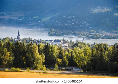 Amazing landscape with pastures, mountains, river and buildings in Lillehammer town, Norway.