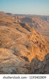 Amazing landscape of rocky mountains and blue sky. Sunrise at Masada, Israel.