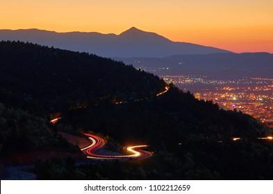 Amazing light streaks over Vodno mountain in Skopje city and Ljuboten peak in distance with twilight sky. Macedonia.