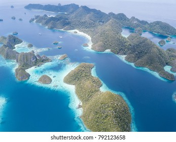 The amazing limestone islands in Wayag, Raja Ampat are surrounded by healthy, shallow coral reefs. This remote, tropical region is known for its extraordinary marine biodiversity.