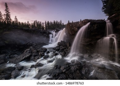 Amazing long exposure of Ristafallet waterfall before sunrise