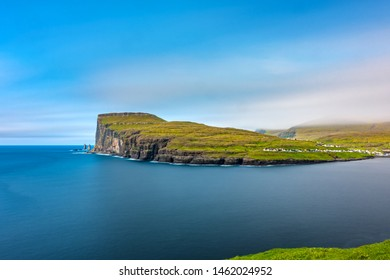 Amazing long exposure view of Eidi and Cliffs in Faroe Islands