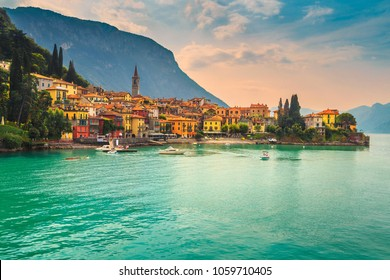 Amazing luxury holiday resort, colorful villas and harbor with kayaks, boats, motorboats in Varenna, Lake Como, Lombardy region, Italy, Europe