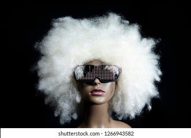 amazing mannequin with LED sunglasses. very 1980s retro. not a real model, this is a mannequin head