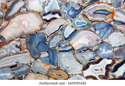 Amazing mesmerizing cross-sectional view gemstones white blue Agate Crystal. Natural agate crystal surface, mineral stone macro closeup.