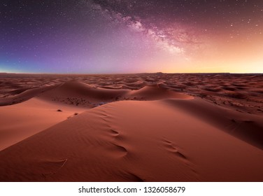 Amazing milky way over the dunes Erg Chebbi in the Sahara desert near Merzouga, Morocco , Africa. Beautiful sand landscape with stunning sky full of stars and night under a starry sky. After sunset