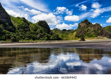 Amazing mirror in Karekare Beach, near Auckland in the North Island of New Zealand