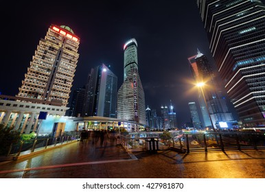 Amazing modern view of skyscrapers on Century Avenue in the Pudong New District (Lujiazui) of Shanghai at night. The Shanghai World Financial Center (SWFC) and the Jin Mao Tower are visible at right.