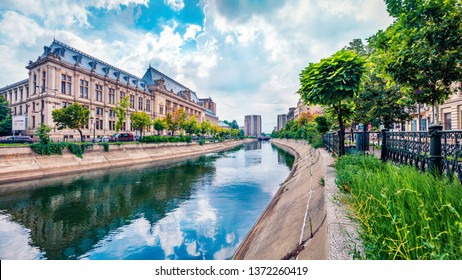 Amazing morning cityscape of Bucharest city - capital of Romania, Europe. Colorful summer view of Court of Appeal Building on tne Dambovita river. Traveling concept background.