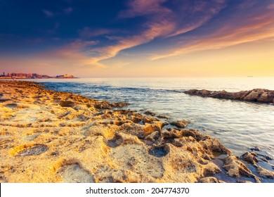 Amazing morning sun over the sea. Volcanic island of Malta. Sliema, Europe. Beauty world. Retro toning effect.