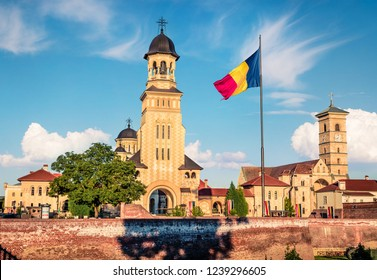 Amazing morning view of bell tower of Reunification Cathedral, Fortified churches inside Alba Carolina Fortress. Splendid summer scene of Transylvania, Alba Iulia city, Romania, Europe.