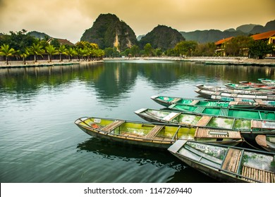 Amazing morning view with Vietnamese boats at river, Tam Coc, Ninh Binh in Vietnam travel landscape and destinations