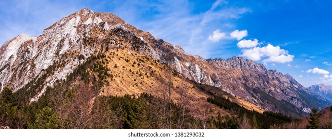 Amazing mountain landscape with colorful vivid on the cloudy sky, natural outdoor travel background. Alps Friuli Italy.