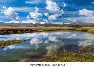 Amazing mountain landscape with river and clouds. Plateau Ukok, Altai