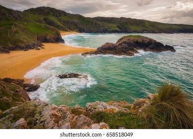 Amazing Murder Hole beach in Donegal, Ireland/ Murder Hole beach/ Amazing beach with the small island on the middle in Donegal coast, Ireland.