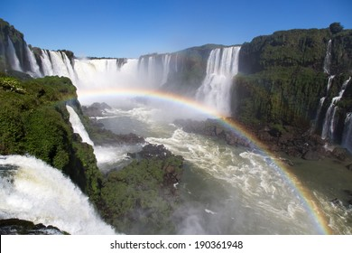 Amazing National Park of Iguazu Falls with a full rainbow over the water, Foz do Iguaçu, Brazil
