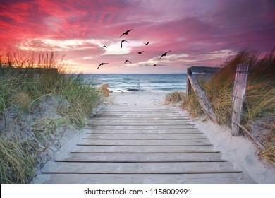 amazing natural beach with wooden jetty - beautiful sunset