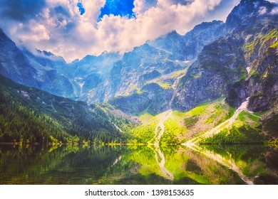 Amazing nature, alpine lake in the mountains, scenic summer landscape with blue cloudy sky and reflection in the water, Morske Oko (Eye of the Sea), Tatra Mountains, Zakopane, Poland