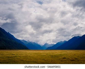 Amazing Nature of Mountains under a Cloudy Sky in Fiordland National Park, New Zealand. On the way to Milford Sound.