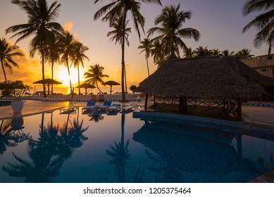 Amazing nature sunset landscape. Tropical blue sea in island Zanzibar Tanzania. Luxury holiday resort. Beautiful travel vacation. Palms in beach paradise. Great panorama view. Inspiring summer.