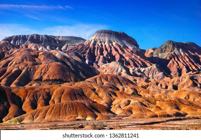 Amazing nature view - bizzare colorful rocks - mountain range against the background of blue sky at sunset time in Maranjab desert, Tehran - Isfahan road, Iran, Middle East, Western Asia